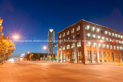 Bricktown heritage buildings at night with modern Devon Energy Center high-rise in distance, Oklahoma City, Oklahoma on Route 66