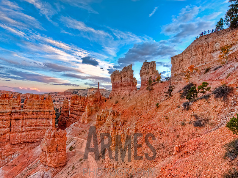 Sunset view of the start of the Navajo Loop Trail from Sunset Point, Bryce Canyon National Park, Utah (note The Sentinel centre view)