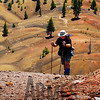 Climbing the Cinder Cone with the Painted Dunes in the background, Lassen Volcanic National Park, California