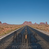 Driving north on the US163. Left of the road: Eagle Rock, The Sitting Hen & The Sleeping Bear. Right of the road: Brigham's Tomb, King On His Throne, Stagecoach, The Bear & Rabbit, Castle Butte & Big Chief. Monument Valley, Navajo Tribal Park, Arizona