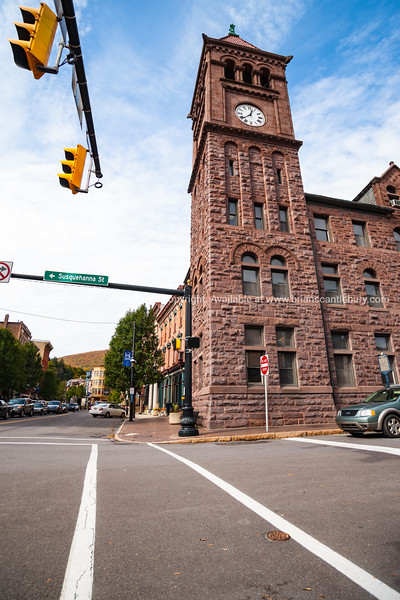 Street intersection in small town with stunning example of red brick heritage architecture.