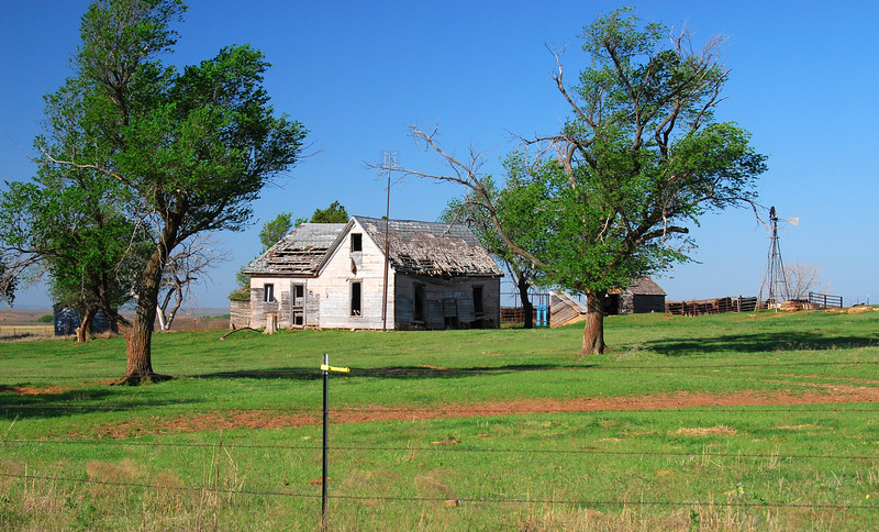 The Oklahoma plains are scattered with old farm buildings...