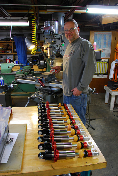 Rick Tanenbaum of Cogent Dynamics pictured with Suzuki Banndit shocks he manufactures