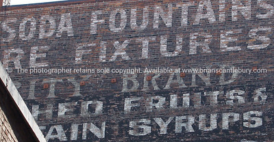Old signed brick wall, Seattle, Pioneer square area.