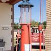 Mobilgas petrol pump at Magnolia Gas Station in Shamrock, Texas. Old Shamrock Fire Dept No 5 truck in background.