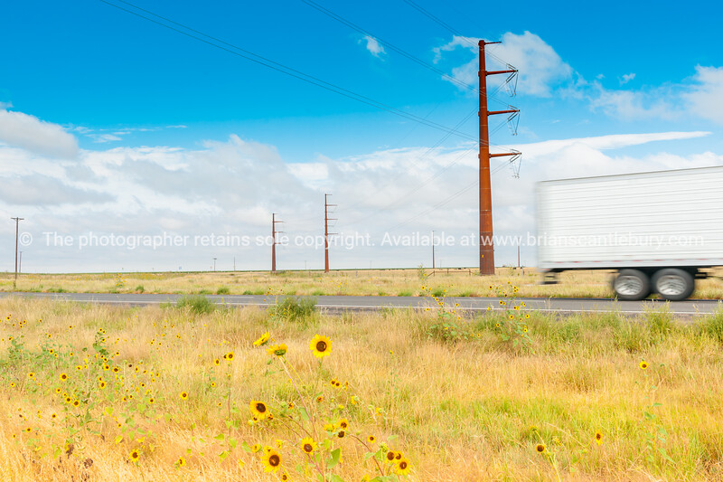 Giant power pylons carry power across rural landscape on Route 66 Texas, USA