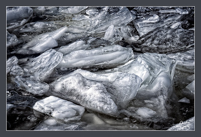 Broken iced river floats