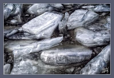 Broken iced river floats