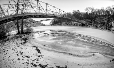 Trail Bridge over a frozen tributary to the Hudson River