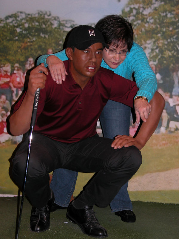Judy helping Tiger Woods line up a put