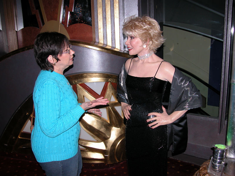 Judy telling Joan Rivers a joke