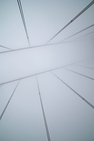 Traveling along the Golden Gate Bridge, I opened the sun roof and snapped this photo of the cables in the fog.
