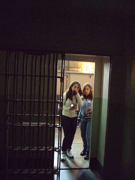 Taken from within solitary confinement at Alcatraz.  These visitors were looking curiously into the darkness of the cell.