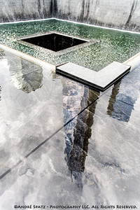 Reflections of the World Trace Center on to the 9/11 Memorial Pool
