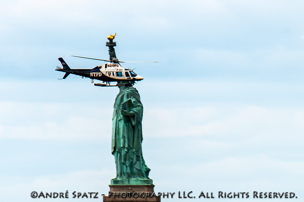 NYPD Helicopter very near the Statue of Liberty