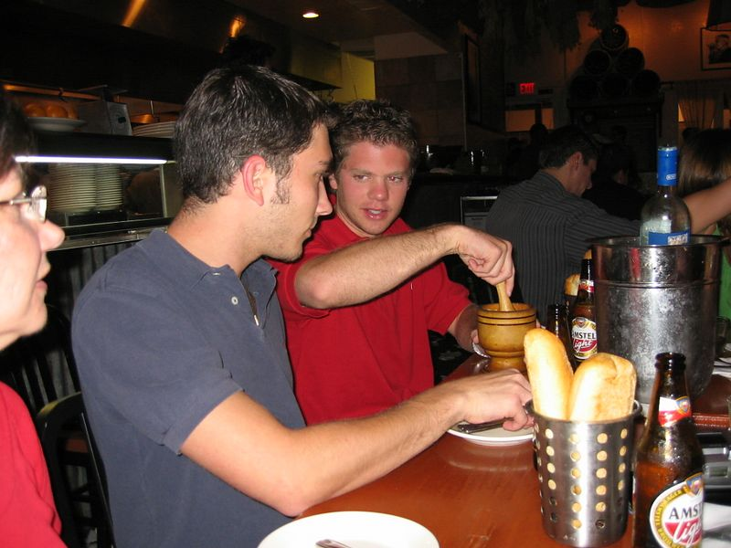 Ben and Eric mashing beans at Opa