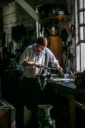Jessie working at James Anderson's Blacksmith Shop