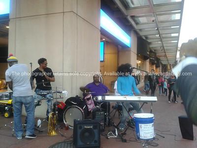 Washington DC street scene, busking musicians. phone