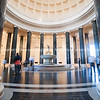 Font in impressive entrance to National Gallery of Art with effect of people blurred in motion