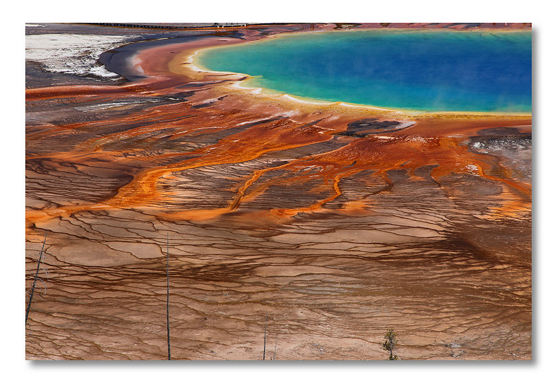 Grand Prismatic Spring, Yellowstone NP. <br /> Most people visit this spring from the flat trail next to it. Bad mistake. You have to hike up a hill to see how incredible this is.  Most photographer are aware of that. For an explanation to the colors, I'll let you google it!