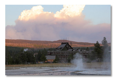 Old Faithfull Inn, fire and geyser, Yellowstone NP.   The geyser eruption is taller than me...