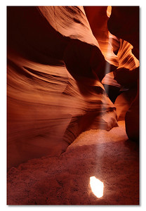 Beam of light, Upper Antelope Canyon, AZ. Do yo have a wet dream? This is my photographer's wet dream. The real story (fake for those who know me) is that I had to kill 10 other photographers to get any spot. No time to thing, At htis time of the year, there a re only two beams visible at only 5 min interval. No time to think!