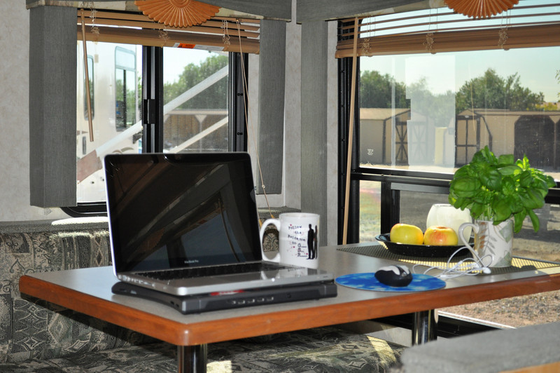 One of the places Cheryl writes at - dining table with view of wherever we're are at the time.