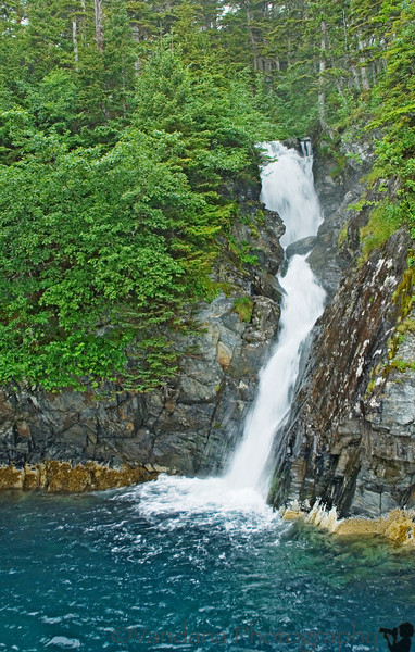 The first stop is a mountain-waterfall. The ship goes quite close to this one, you can practically touch it.