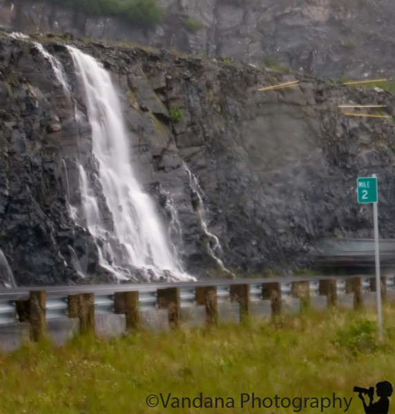 Decide to cut the trip short as the weather's really un-cooperative. Still foggy & washed out. Note the preferred method of drainage along Kodiak roads -  road-side waterfalls :)