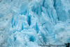 You hear a glacier calving before you see it.. The sound is a loud pop like that of a gunshot. The visual can be a bit tame, as finding the spot where it calved takes a while, by which time parts of the glacier have broken up into giant icebergs.