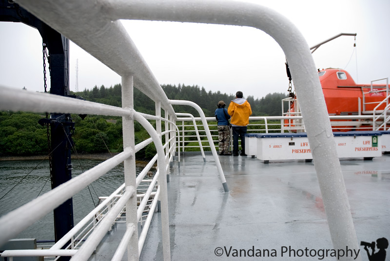 Vandana & Swami look out towards Kodiak as Tustumena sets sail. We still haven't figured out where we're going to stay on tusty, as we don't have a stateroom ( cabin ) reservation.