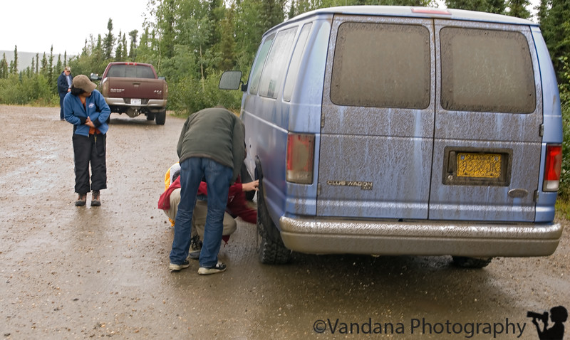 Bill must have driven over a pothole cause we started hearing a grating noise every so often. At the Arctic Circle, he decided to investigate further. But the van yielded no secrets & we decided to keep on driving.
