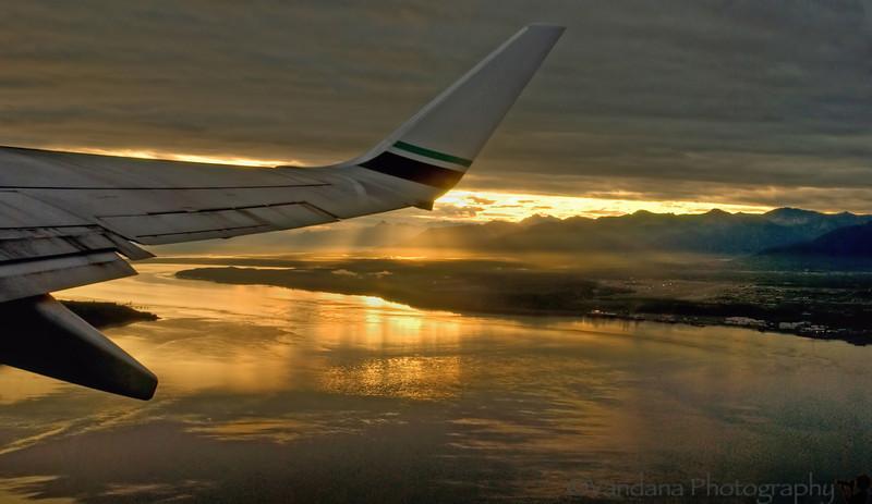 July 24, 2007 - 6am flight to Kodiak Island. Everyone's dozing, save V, who clicks this Alaska Airlines wing thru the window.