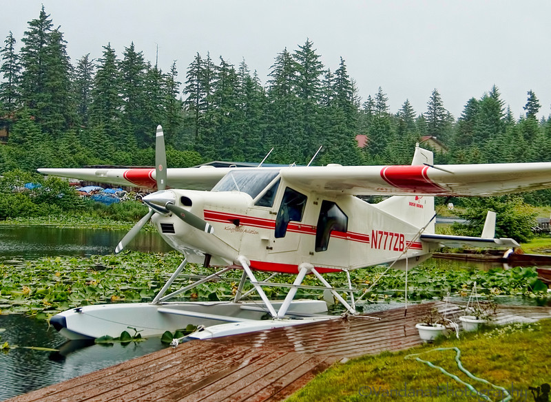 """At Kodiak, we have a scheduled appointment with <a href=""""www.Kingfisheraviation.com"""">Kingfisher Airlines</a> in an hour. We pick up a van at the airport & drive to Kingfisher in a hurry, only to be uinformed we aren't going to make it up to Frazier Lake today :(  It isn't their fault, just one of the 100+ foggy+cloudy+rainy Kodiak days, when visibility is poor and floatplanes aren't allowed to operate.  btw, that's the floatplane we were supposed to be on.   The entire week is forecast to be cloudy. Fortunately, we're departing to Unalaska the next day. We reschedule for a week hence & get back on the road."""