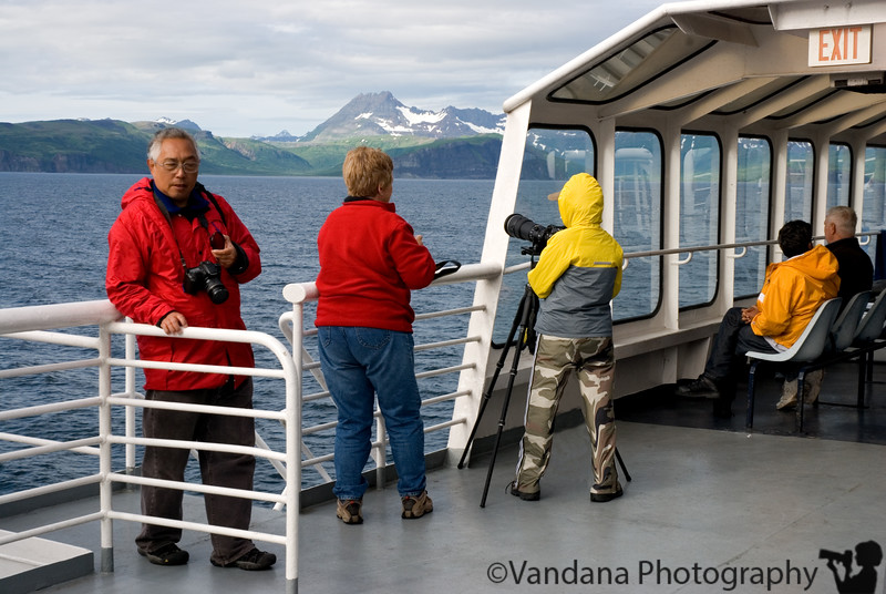 The Motor Vessel Tustumena arrives!<br /> <br /> We excitedly board MV Tustumena ( trusty Tusty) in Kodiak for a weeklong cruise to Aleutian Islands.<br /> <br /> My plan is to set up two tents in the solarium and house the family in there. The first tent is supposed to be where that tripod is perched, and the second one next to that.<br /> <br /> So where are the tents ? Well, we tried real hard. The rain came pouring down and it was so windy, the tent rods snapped like a twig, I kid you not!<br /> <br /> I was so frustrated I threw the brand-new tents into the garbage can :)