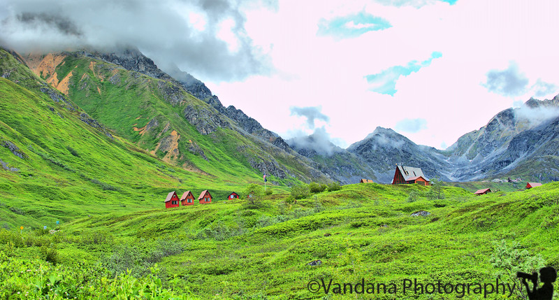 As we arrive closer to Hatcher pass, the tint red log cabins come into view.