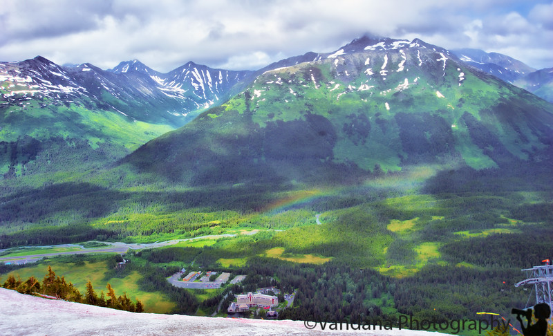 That tiny building right at the bottom center is the Alyeska Hotel & Resort. Spot the makings of a rainbow but it vanishes just as quickly as it appeared.