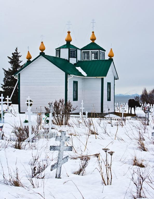 Russian Ortodox Church at Ninilchik with visiting moose.