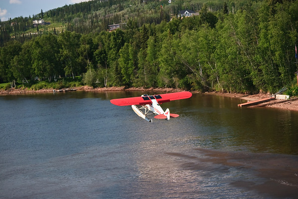 Float plane takeoff along banks of the Chena River