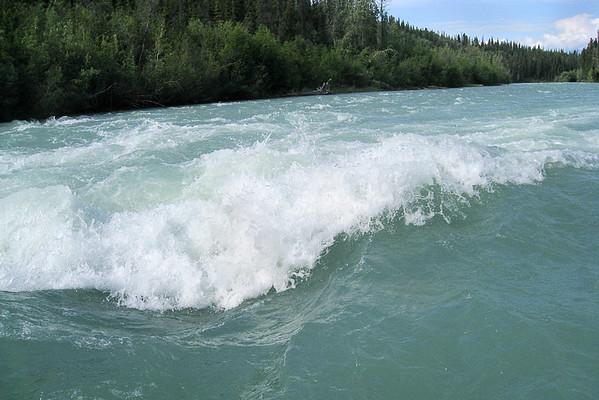 The river swirled around us