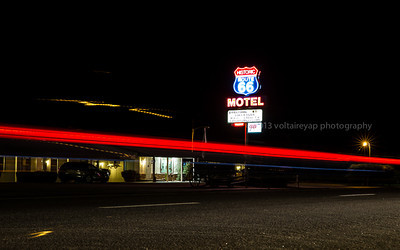 Lone car passes by the old Route 66.