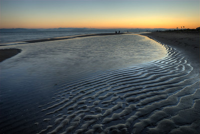 © Joseph Dougherty. All rights reserved.   Sunset reflected in sand ripples at Crown Memorial State Beach, Alameda, CA.