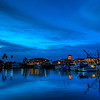 © Joseph Dougherty.  All rights reserved. <br /> <br /> Breaking dawn over Ventura Harbor.  Fishing boats and marina lights reflected in the calm waters.
