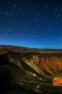 © Joseph Dougherty. All rights reserved.   Star trails above Ubehebe Crater on the night of a crescent moon.   Death Valley National Park.