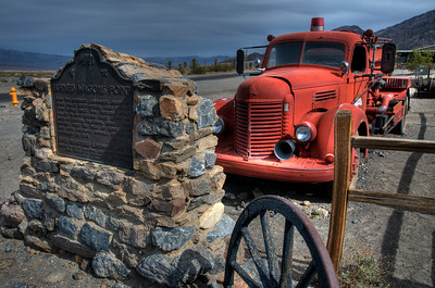 © Joseph Dougherty. All rights reserved.   Burned Wagons Point historic marker and old antique fire truck.  Death Valley National Park.