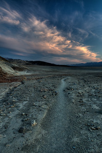 © Joseph Dougherty. All rights reserved.   A single-track trail through Death Valley at sunset.   Death Valley National Park.