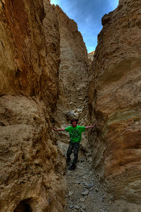 © Joseph Dougherty. All rights reserved.   Climbing in a side branch of Golden Canyon, exploring a shallow slot canyon.   Death Valley National Park.