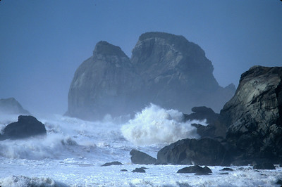 © Joseph Dougherty. All rights reserved.   Large waves crashing against coastal rocks.