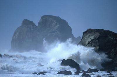 © Joseph Dougherty. All rights reserved.   Large waves crashing against coastal rocks.