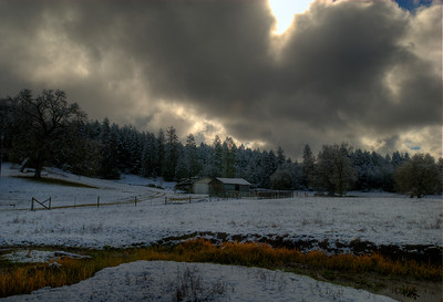 © Joseph Dougherty. All rights reserved.  Breaking clouds over a small ranch near Laytonville, CA;  atypically low elevation snows blanketed the area late in the spring.